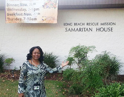 Aisha Henderson in the El Segundo, Calif., office of the Aerospace and Sciences Engineering Division delivers food and supplies to the residents of the Long Beach Rescue Mission at Thanksgiving.